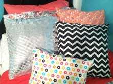 Each bed featuring 5 new pillows, all sewn together by Miss Shannon. here are Joeli's.