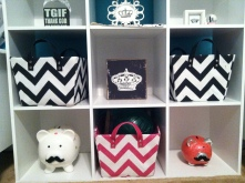 Shelving from the basement was repurposed with new chevron baskets and mustaches placed on already owned, but empty pigg banks.