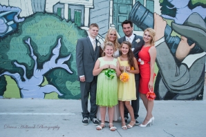 My family standing in front of the new mural in Downtown Sylvania painted by Dani Fuller