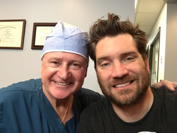 Dr. Kozy and I, minutes after the procedure.  My body full of Valium and a mouth filled with a brighter future.