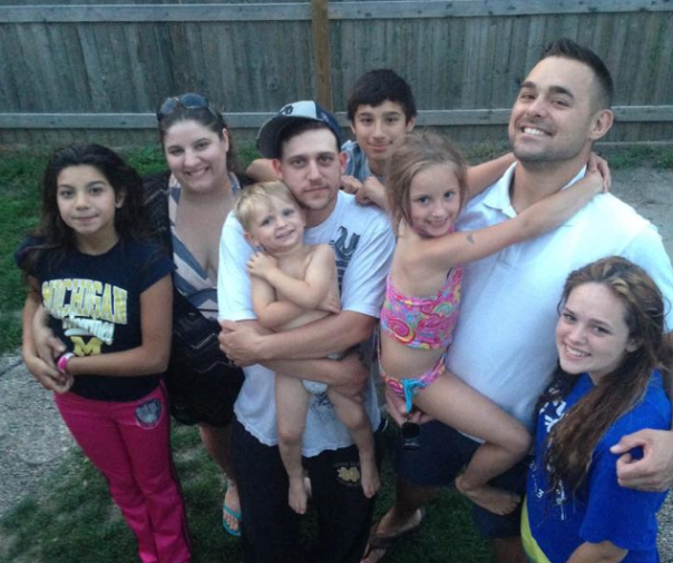 Sarah and her family. (pictured left to right: Kayla, Sarah, Baby Nick & Dan, Ricci, Maddie and Chris, and Kyleigh